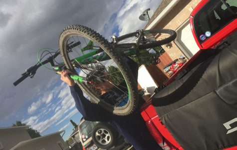 Here is Daniel Jones setting his bike in the truck to get ready for practice.