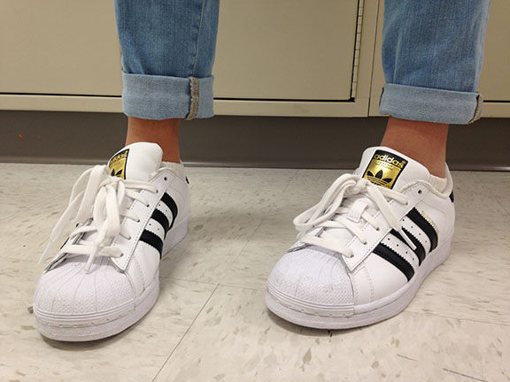 Throughout the halls many girls are wearing the Superstar Adidas, modeled by Sophie Salzar, 8th grader.
