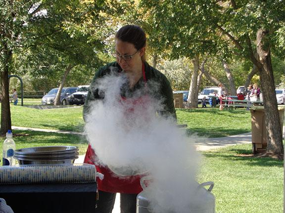 A subzero employee makes ice cream for students on a field trip at Draper Park