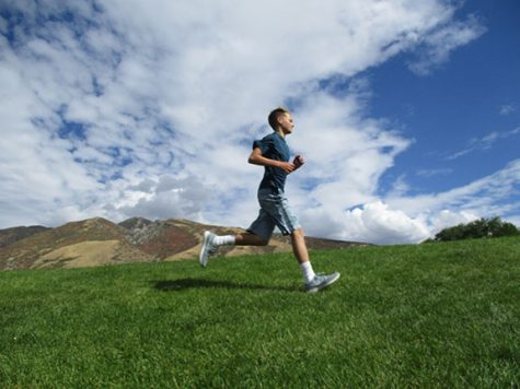 Cross country runners condition for Fall season