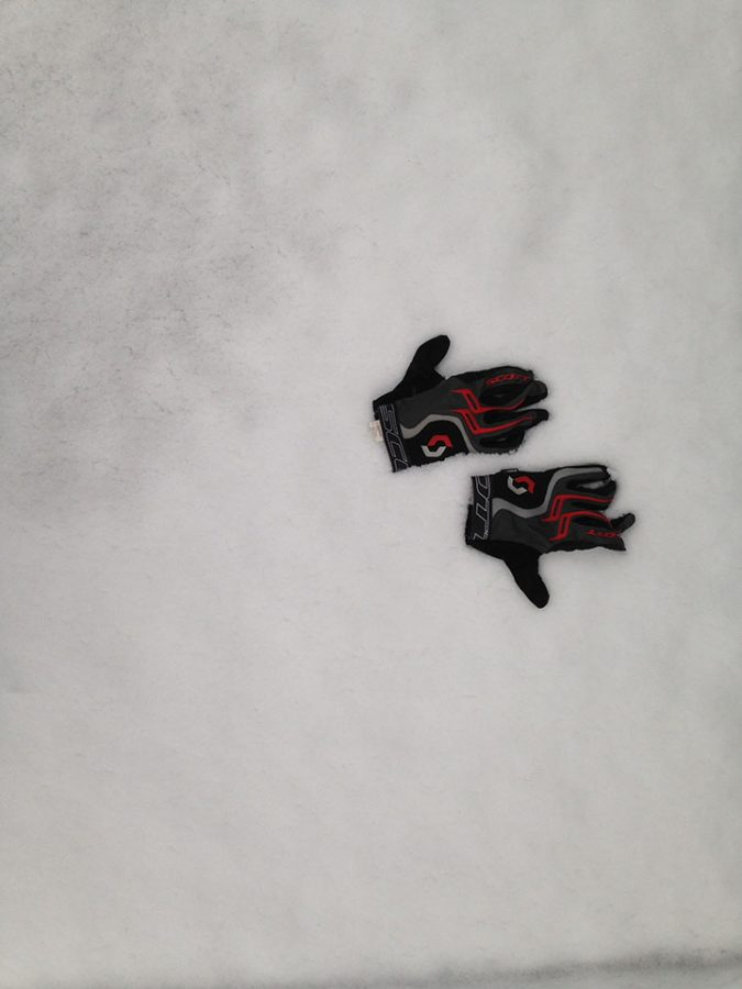 Photo of bike gloves in the snow