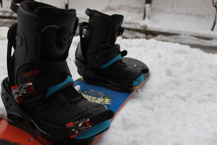 A closeup of the snowboard boots shows deep detail in their design.