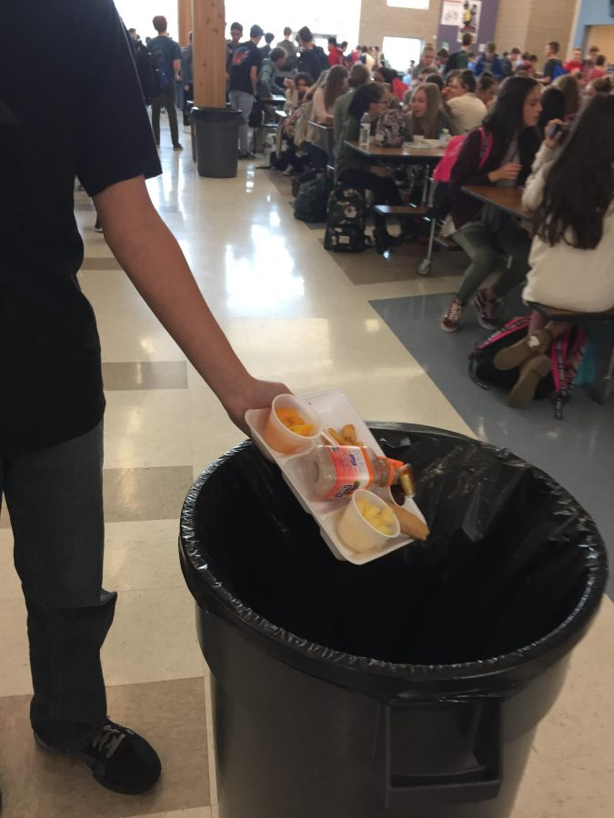 Phillip Mell a DPMS student is throwing away his lunch with plenty of food still on it in the school cafeteria on January 4th 2017.
