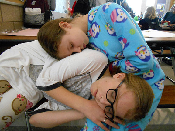 7th graders, Katie Burnett and Rachel Oldham sleeping after they eat their lunch on pajama day because they got to comfy in their pajamas.