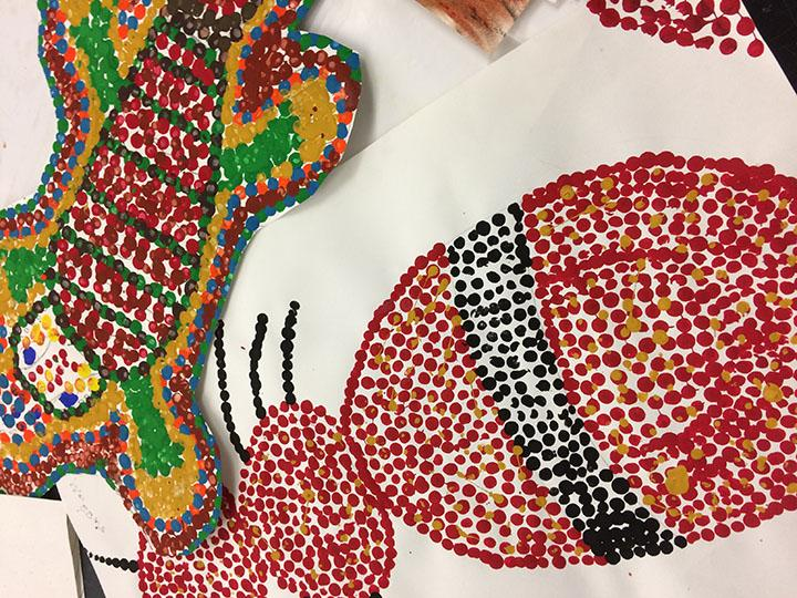 Dot paintings made by art three students.