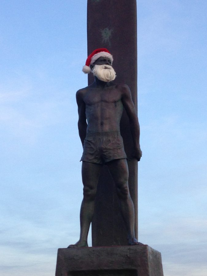 The statue of a surfer is decorated as Santa in San Francisco on December 27, 2016.