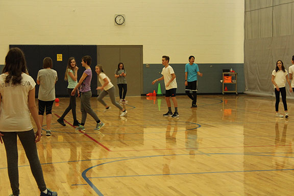 The seventh graders taking a break from classes, and playing capture they flag in PE.