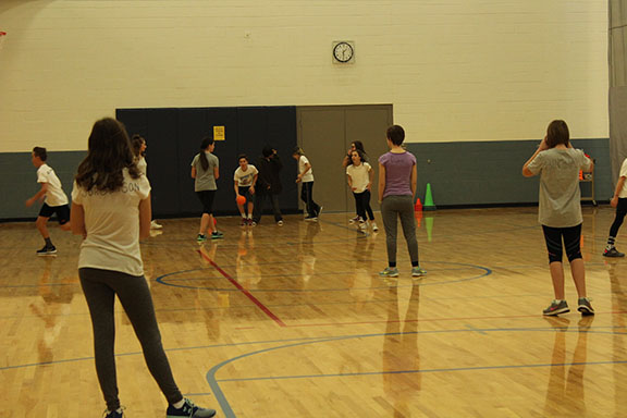 At school in the gym Mrs Levitt's PE class gets some exercise during their school day.