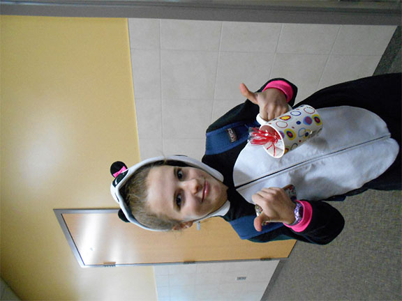 Elizabeth Johnson, 7th grader, wearing her panda onesie, is waiting to go into her 5th period class on pajama day.