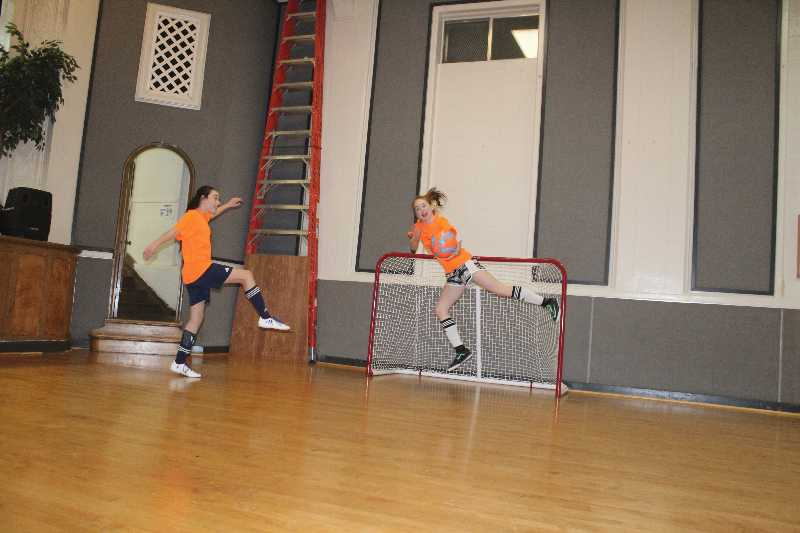 Madeline Fuhrken and Ella Carmondy practice indoor soccer at a church in Midvale.