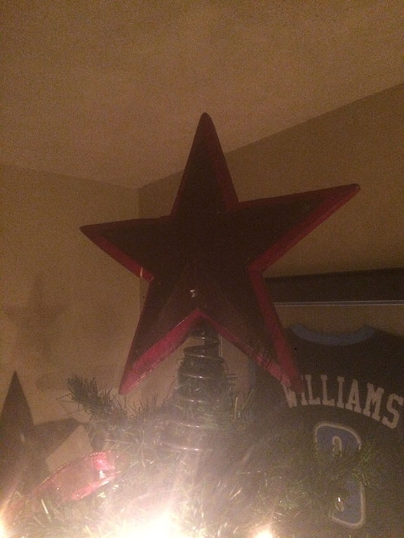 Star of a Christmas tree with light shining on it January 5th 2017