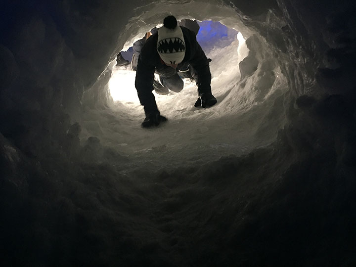 At the Ice Castles in Midway, Utah, there are some tunnels that people who can fit in it are allowed to crawl through. Here is a shot of Logan Rees coming out of one. Taken on January 6th.
