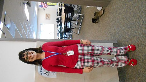 6th grade teacher, Audrey Withycombe, wearing her pajamas as she welcomes her students into class on pajama day.