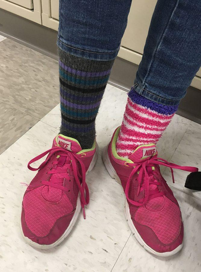 Rachel Oldham wore miss matched crazy socks to school and posed by her locker for a photoshoot.
