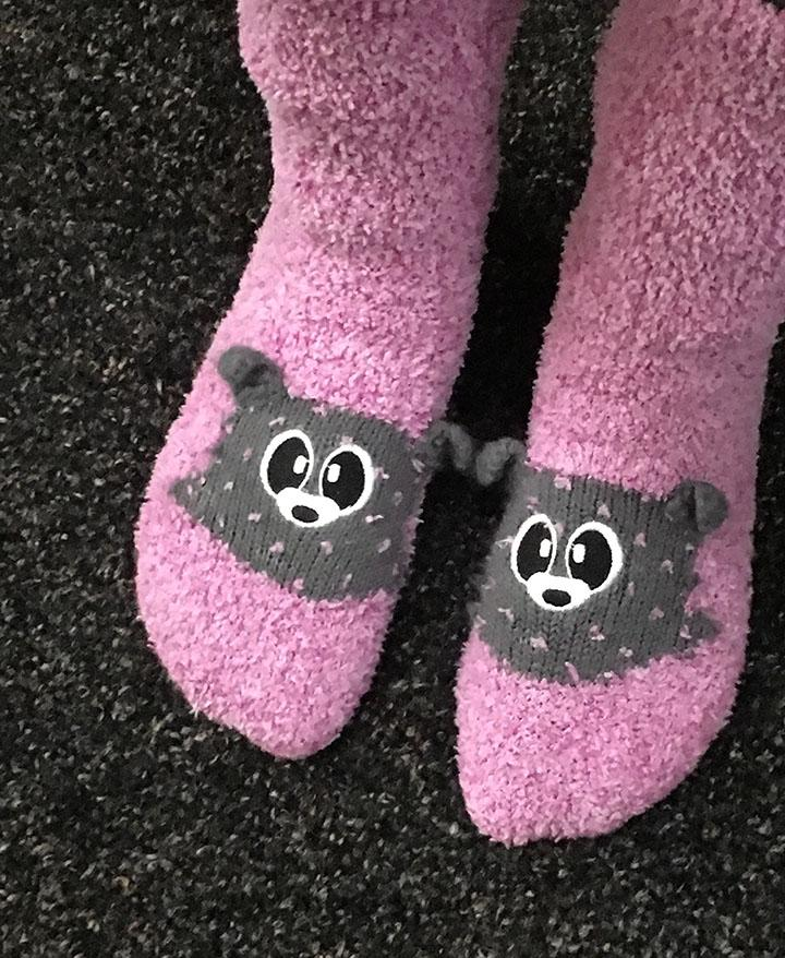 Olivia Lewis shows off her fluffy puppy socks for a picture just as she enters the school.