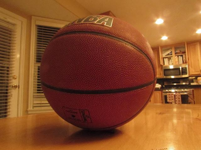 Showing this basketball.