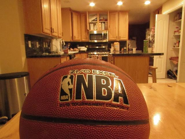 The NBA sign on a basketball.