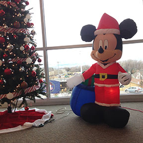 Mickey Mouse inflatable by a Christmas tree in the library on December 15, 2016.