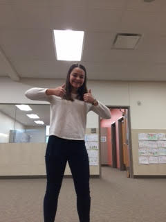 Savannah Romney, member of NJHS, smiling because she likes doing service.