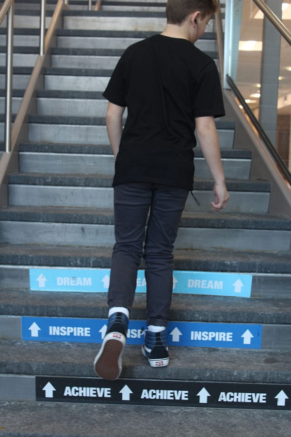 Cole Johnstone following school rules by walking up the right side of the stairs.