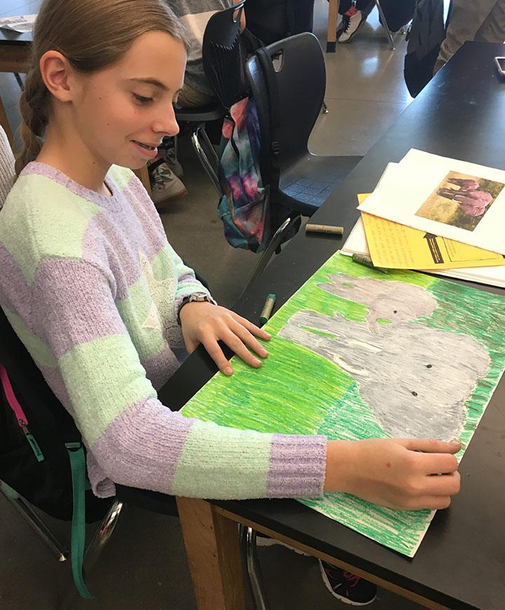 Ashley Neilson, 7th grader, works on her project she will soon be turning in during class on February 13, 2017.