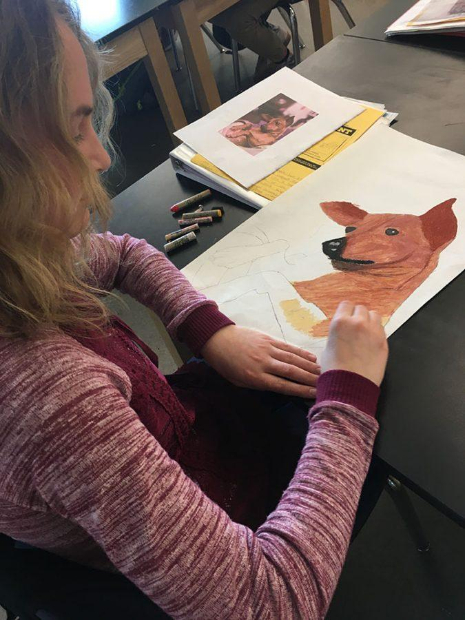 During Art 1 on February 13, Avery Hartey uses oil pastels to color in her grid drawing project.