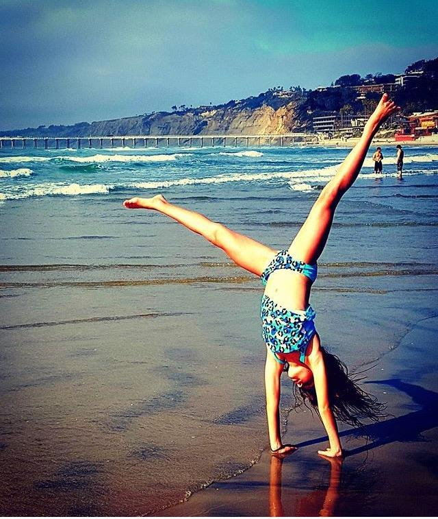 Avery Tiffany does a cartwheel on the beach on June 4th, 2016.