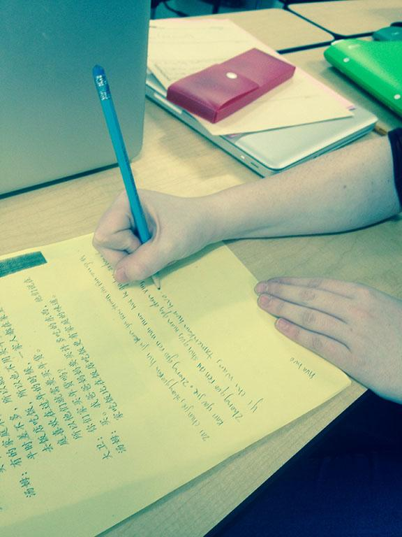 Ade Muhlstein writing on a Chinese worksheet on February 24.