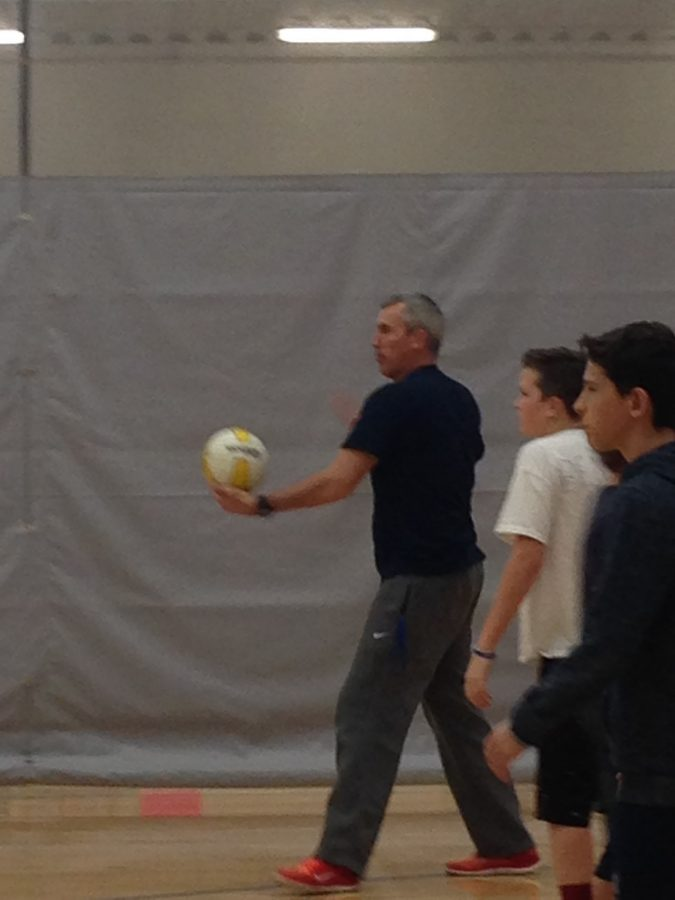 February  28th, Volley ball in the P.E. room, Mr. Baker is getting ready to serve the ball