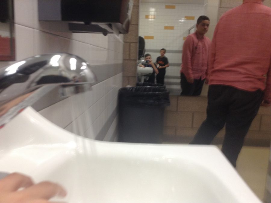 This is a photo of Isaac Varela leaving the sink with the water on, because he did not care about water conservation