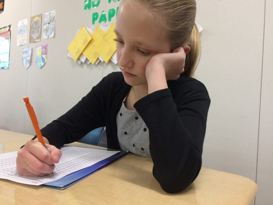 Avery Hewitson is taking a test in Tania Kenney's classroom on February 16.