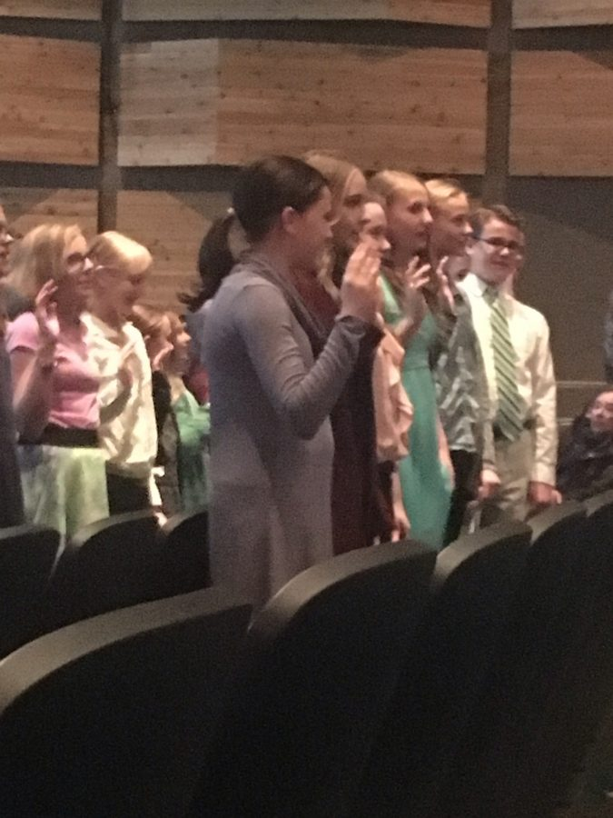 This is at the NJHS swear in, the students in the picture are reciting a pledge.
