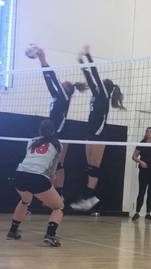 This is Brooklyn Leggett and Baylee Bodily about to spike the ball in a volleyball tournament. At about 11:00 during there game.