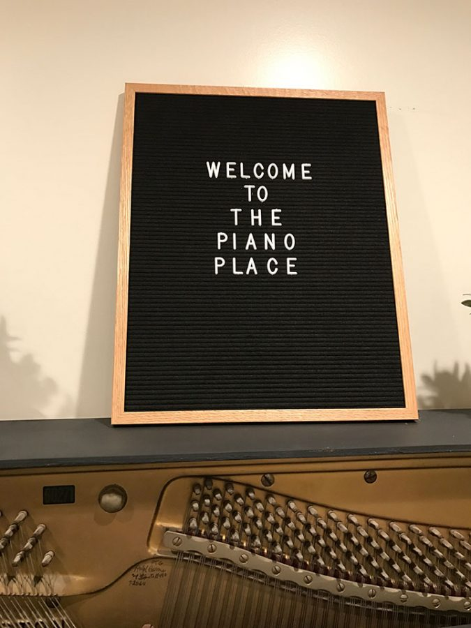 This is a photo of the piano place welcoming sign.