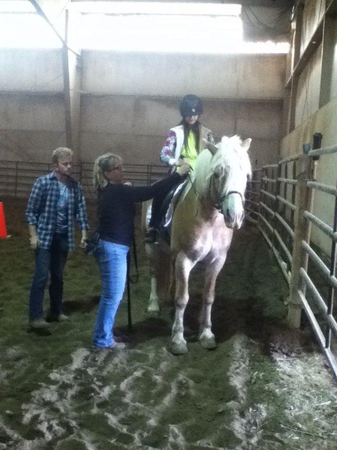 Savannah Smith is learning how to vault on a horse in a barn April 9, 2015