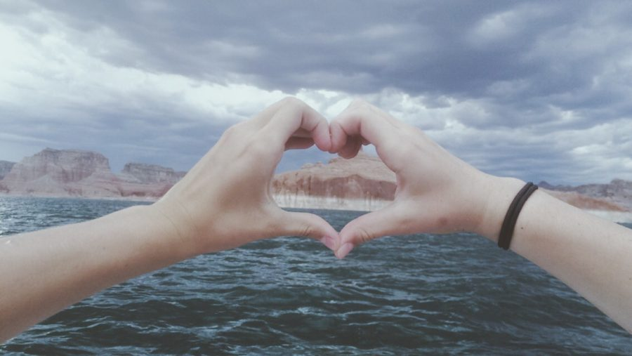 Taken in Lake Powell, the hands making the heart are Lily Baird and Macy Watts, in June 2016.