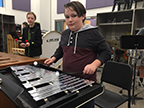 Jake, a percussion student is playing the bell kit. Photo taken of 2/15.