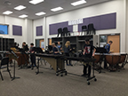 Group 1 of the percussion ensemble playing their instruments on 2/15.