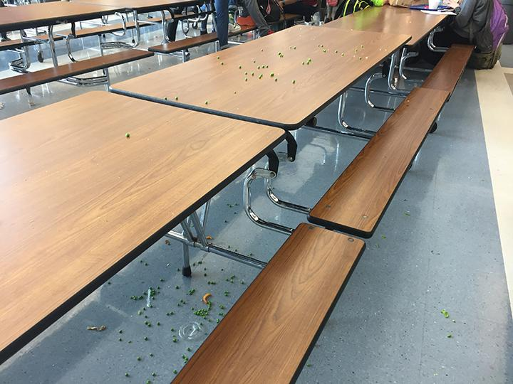 A photo of a students peas all over the table and ground. Photo taken on 2/27.