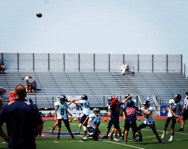A kid throwing a football to his receiver on August 23rd at West valley high school.