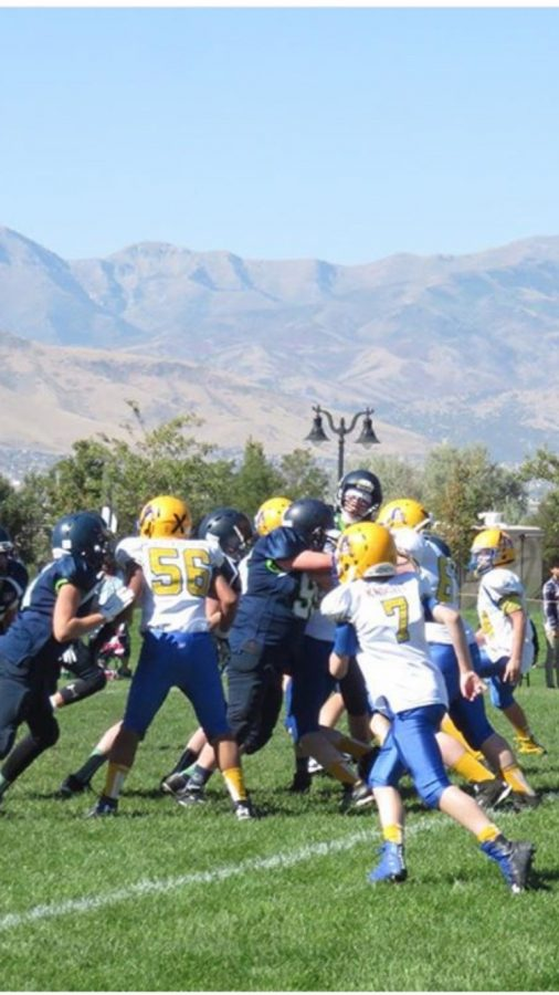 A kid getting blocking for is running back on August 30th at cyprus high school.