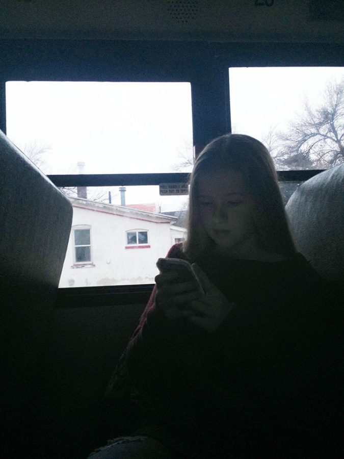 This is a picture of Lucie Packer, 7th grader, she is on a Draper park middle school school bus after looking at the air pollution looking up affects of it.