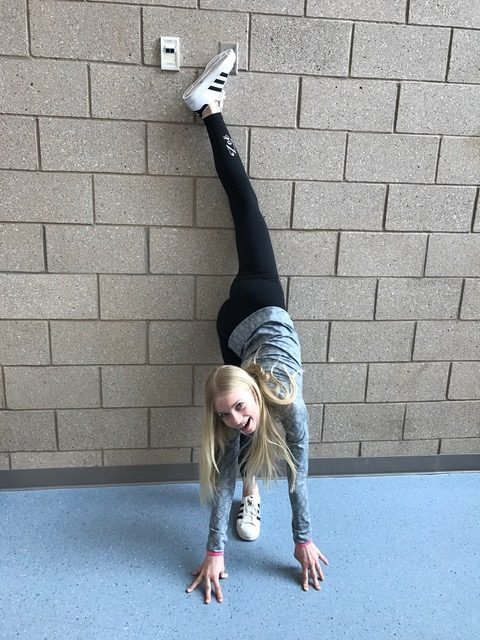 Zoe Sisam, an 8th grader, is doing a wall split at Draper Park Middle School on February 22, 2017.