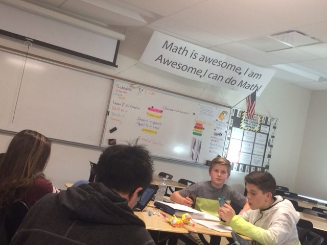 Debaters Leith Sherman (far right), and Isabella Nibley (far left) prepare for a debate on February 16, 2017 at DPMS (Mr. Armstrong's room) while Thane Zeeh and Joe O'Neill watch and help.