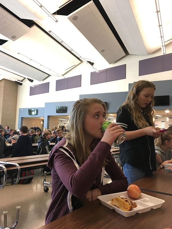 Kira Lang eating lunch with friends while enjoying her soda, taken at DPMS on 2/24/17.