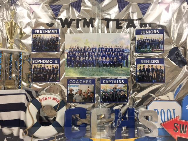 Seasonal pictures of the Corner Canyon swim team on display in the common room on February 16th.