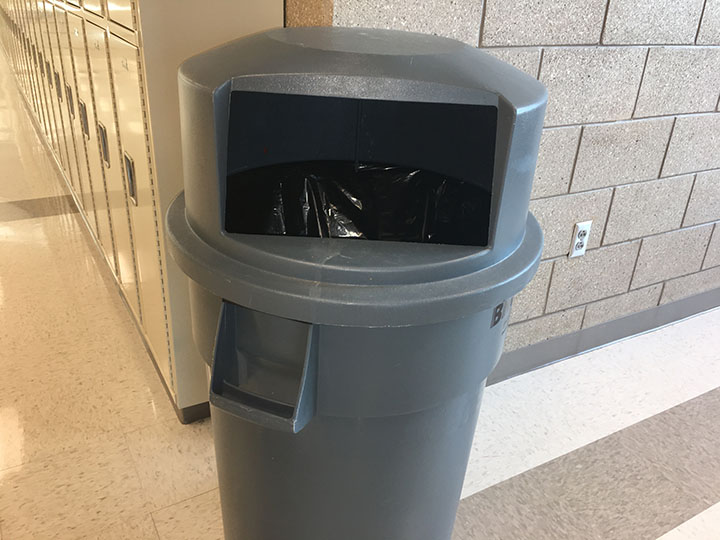 This is an image of a trash can at Draper Park Middle School located in Draper, Utah. It is a reminder of where to throw away trash, and not uneaten food. This photo was taken February 21, 2017.