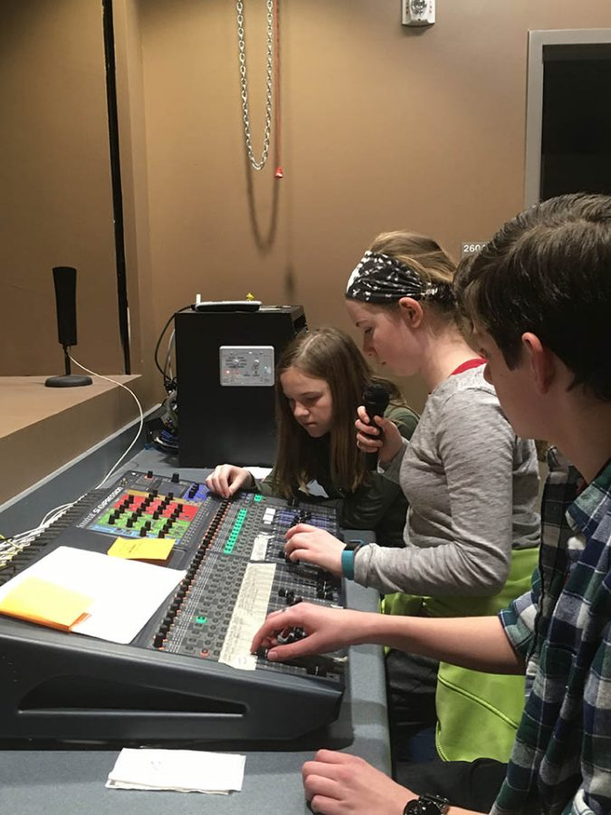 Three students working in the sound booth at DPMS  2/27/17