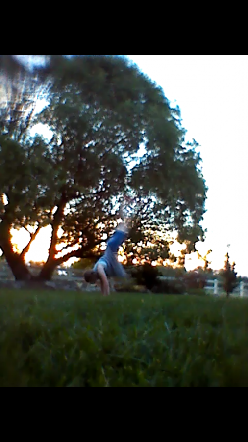 Avery Tiffany doing a backhand spring in her backyard during the summer.