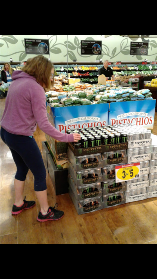 Victoria Paul looking at a monster energy drink at Harmons taken February 25th